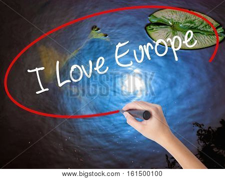 Woman Hand Writing I Love Europe With Marker Over Transparent Board