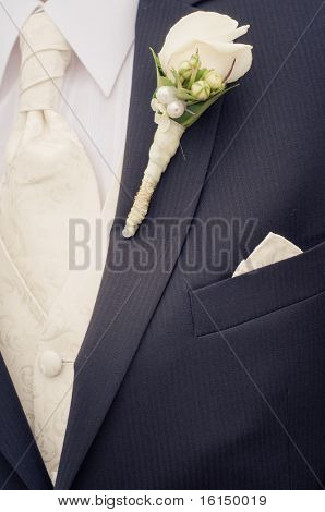 White rose boutonniere on groom's suit