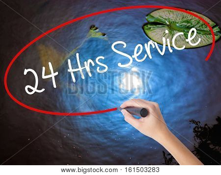 Woman Hand Writing 24 Hrs Service With Marker Over Transparent Board