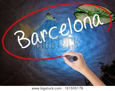 Woman Hand Writing Barcelona With Marker Over Transparent Board