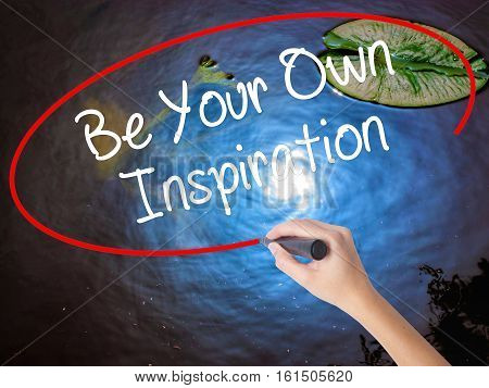Woman Hand Writing Be Your Own Inspiration With Marker Over Transparent Board.
