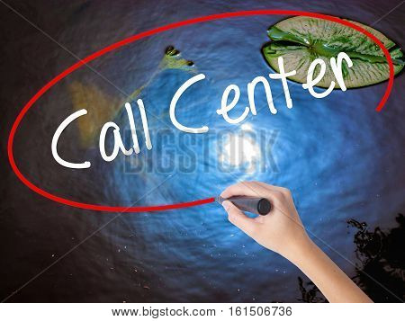 Woman Hand Writing Call Center With Marker Over Transparent Board.