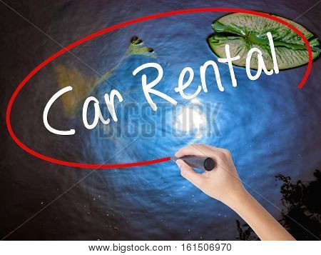 Woman Hand Writing Car Rental With Marker Over Transparent Board