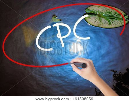 Woman Hand Writing Cpc (cost Per Click)  With Marker Over Transparent Board