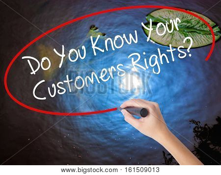 Woman Hand Writing Do You Know Your Customers Rights? With Marker Over Transparent Board.