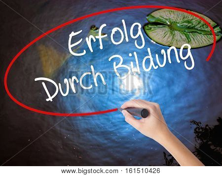 Woman Hand Writing Erfolg Durch Bildung  (success Through Training In German) With Marker Over Trans