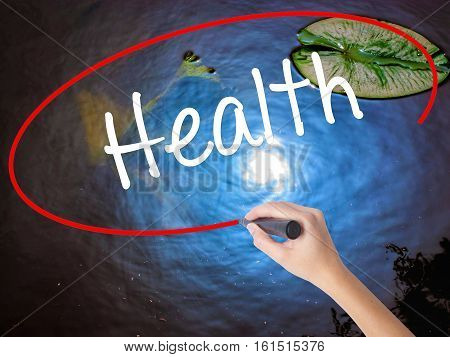 Woman Hand Writing Health With Marker Over Transparent Board