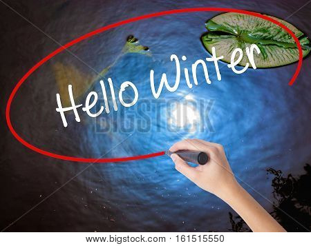 Woman Hand Writing Hello Winter With Marker Over Transparent Board