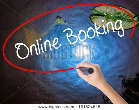 Woman Hand Writing  Online Booking  With Marker Over Transparent Board