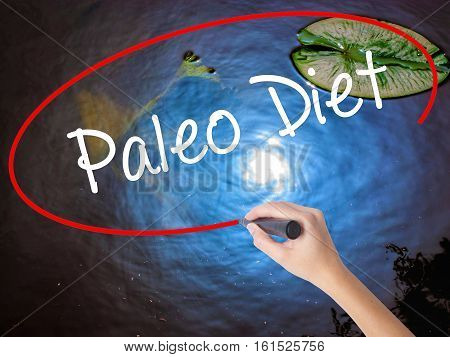 Woman Hand Writing Paleo Diet With Marker Over Transparent Board
