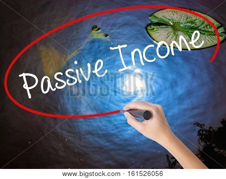 Woman Hand Writing Passive Income With Marker Over Transparent Board