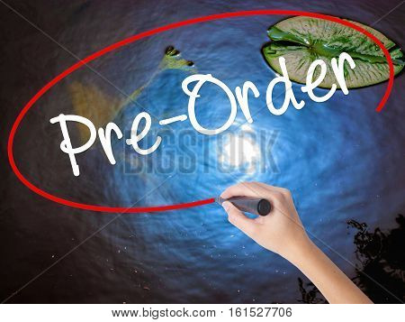 Woman Hand Writing Pre-order  With Marker Over Transparent Board