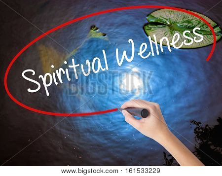 Woman Hand Writing Spiritual Wellness With Marker Over Transparent Board