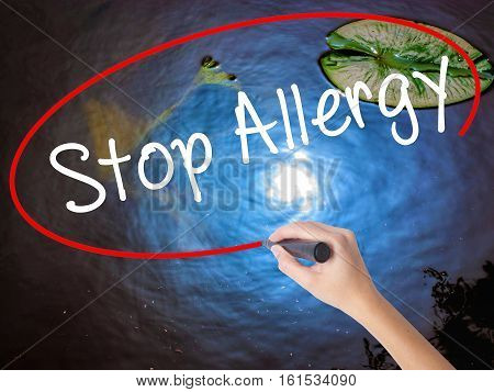 Woman Hand Writing Stop Allergy  With Marker Over Transparent Board