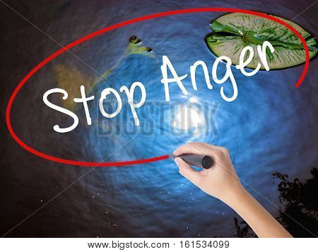 Woman Hand Writing Stop Anger With Marker Over Transparent Board