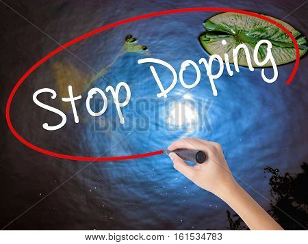 Woman Hand Writing Stop Doping With Marker Over Transparent Board