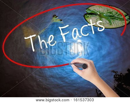Woman Hand Writing The Facts  With Marker Over Transparent Board