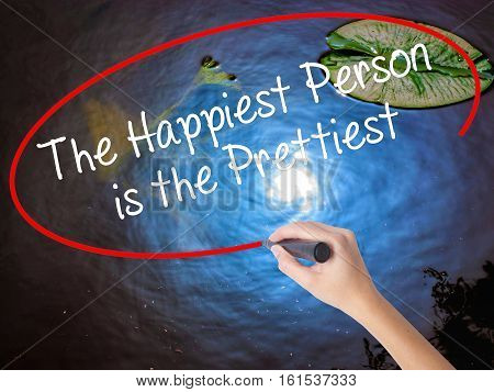 Woman Hand Writing The Happiest Person Is The Prettiest With Marker Over Transparent Board.