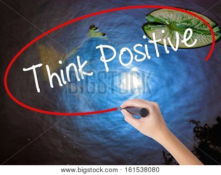 Woman Hand Writing Think Positive With Marker Over Transparent Board