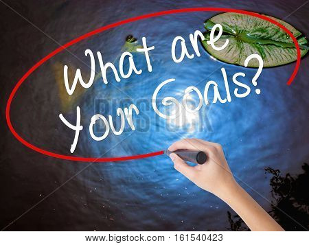 Woman Hand Writing What Are Your Goals?  With Marker Over Transparent Board