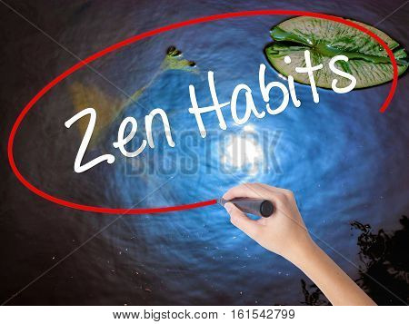 Woman Hand Writing Zen Habits With Marker Over Transparent Board