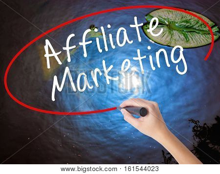 Woman Hand Writing Affiliate Marketing With Marker Over Transparent Board