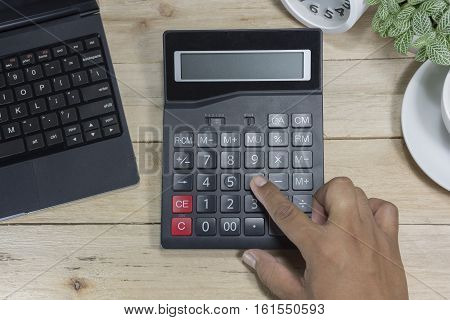 Cashier Men Hand Calculator Wooden Table In The Store With Calculator, Clock Calculator Credit Cards