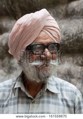 Chandigarh, India. 31 may 2009:  Closeup portrait of an old Sikh, a Rock garden, the second most visited tourist attraction in India after Taj Mahal. The foothills of the Himalayas, Northwest of India, Chandigarh, capital of Punjab and Haryana.