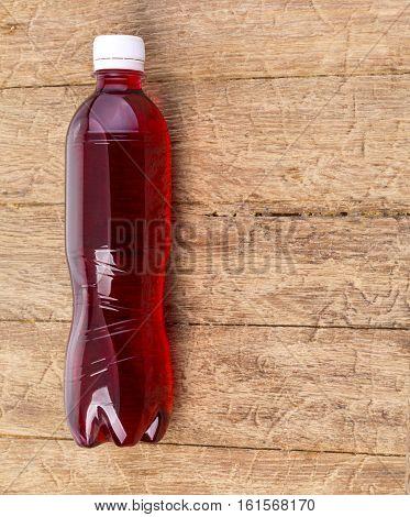 Soda Bottle On The Woode