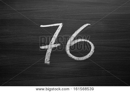 number seventy six enumeration written with a chalk on the blackboard