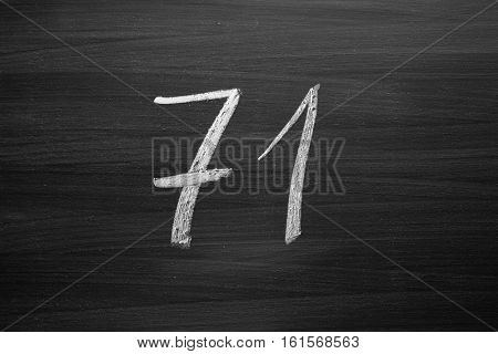 number seventy one enumeration written with a chalk on the blackboard