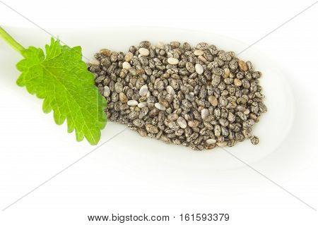 Pile of chia seeds on a white background clipping path