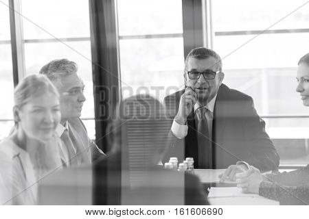 Multi-ethnic business people having discussion in board room at office