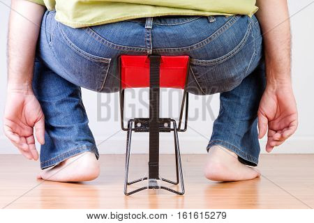 Overweight Barefoot Man Sat On Tiny Chair