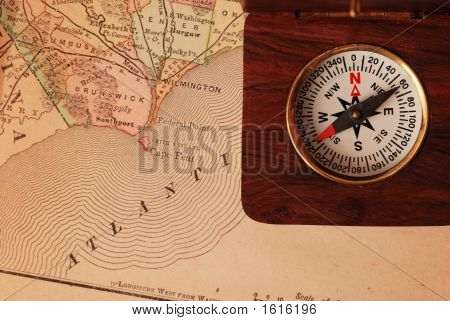Antique Wooden Compass Over Old Usa Map