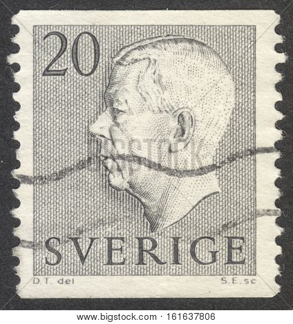MOSCOW RUSSIA - CIRCA NOVEMBER 2016: a post stamp printed in SWEDEN shows a portrait of King Gustaf VI Adolf the series circa 1952