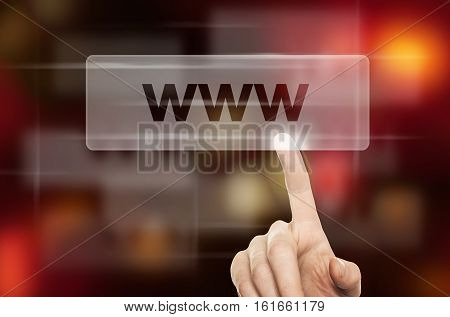 WWW Concept and Male Hand Pressing a Web Button on Blurred Abstract Background