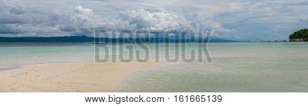 Sandy Bank on Kri Island, Low Tide, Gam in Background. Raja Ampat, Indonesia. West Papua