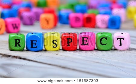 Respect word on wooden table close up