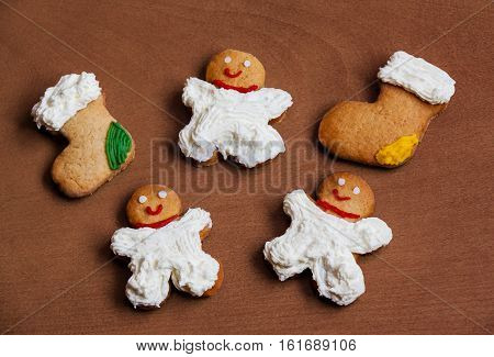 Christmas homemade cookies with cream on wooden background