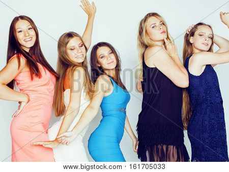 group of many cool modern girls friends in bright clothers together having fun isolated on white background, happy smiling lifestyle people concept