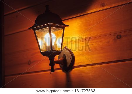 exterior lantern on wooden house