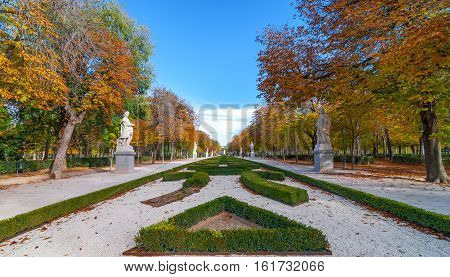 Beautiful autumn day walking in Retiro Park of Madrid, Spain.   People - citizens and tourists alike - take advantage of beautiful weather conditions.