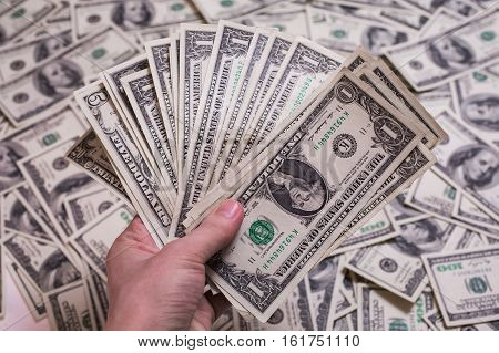 fan of money a fan of one dollar bills one dollar bill face thirst for wealth detail renting pocket money money background