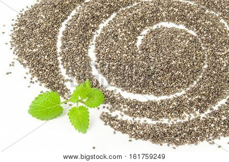 Nutritious chia seeds on a white background clipping path