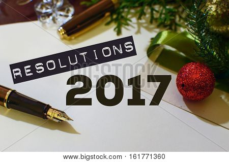 New Years resolutions note pad paper and pen for writing Goals and plans list for the new year social media image postcard or background with copy space