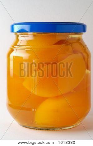 Glass Jar Of Prerserved Peachers (1)