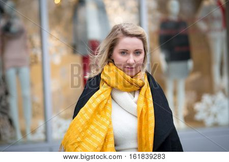 Winter portrait of young Caucasian woman in apparel district photographed in NYC in December