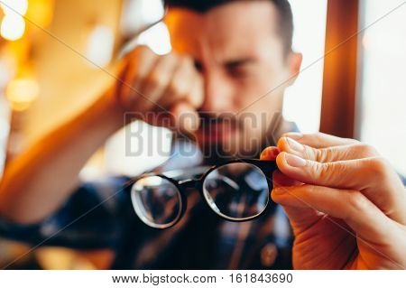 Closeup Portrait Of Young Man With Glasses, Who Has Eyesight Problems