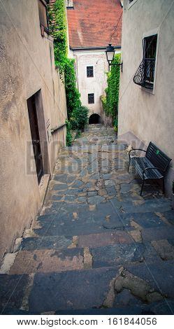 Narrow alleyway in  Durnstein Austria and a bench